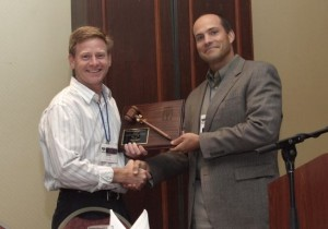 president-loete-presents-past-president-brian-curley-with-gavel-plaque-resized-300x177